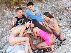 Horny chicks pulverize on the beach